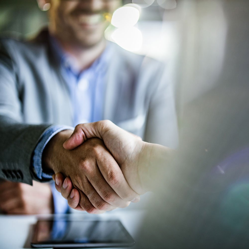 Trustworthy man shaking hand of client